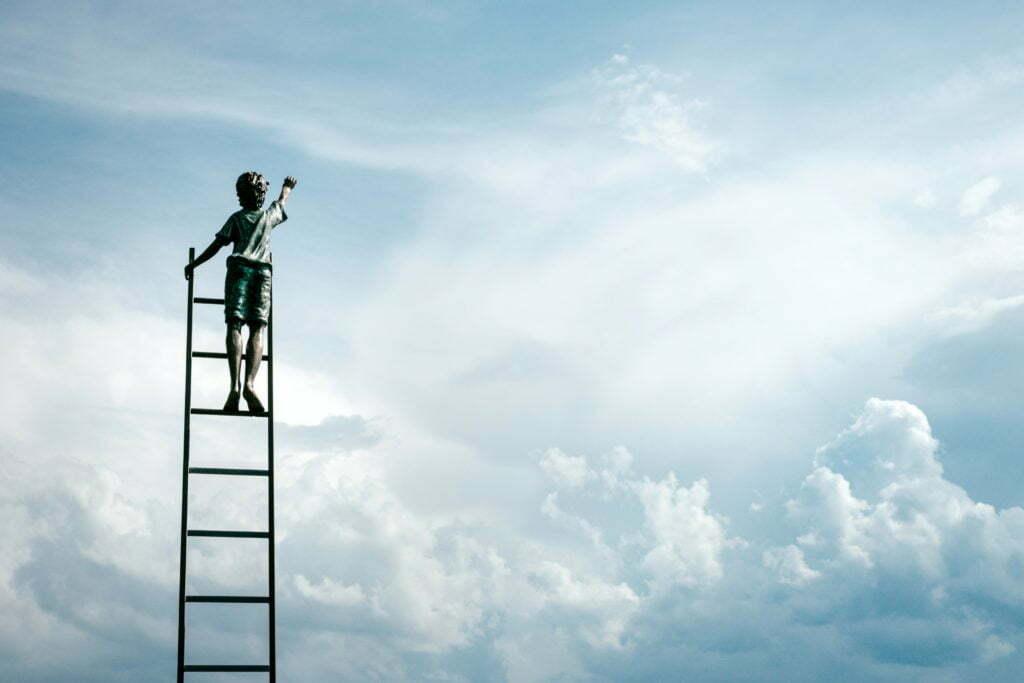 boy on ladder in sky