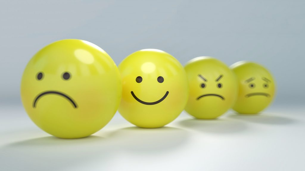 yellow faces angry and happy